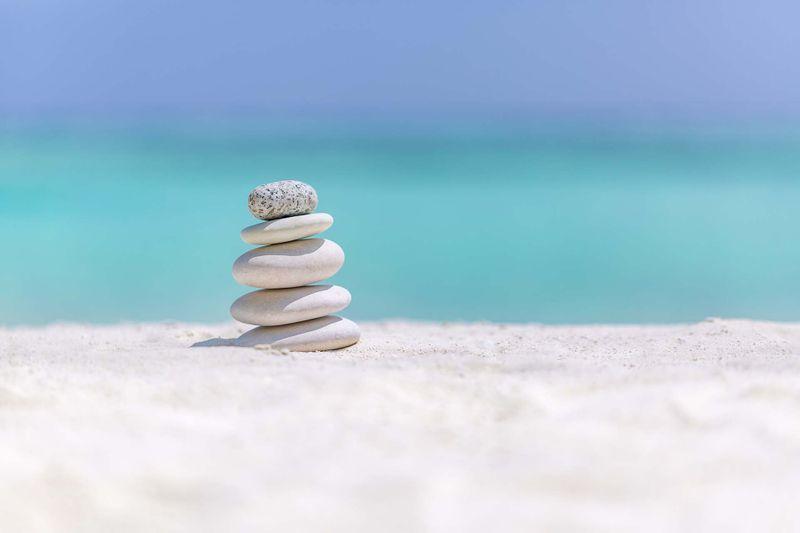 bigstock-Zen-Stones-On-Tropical-Beach-F-268500223